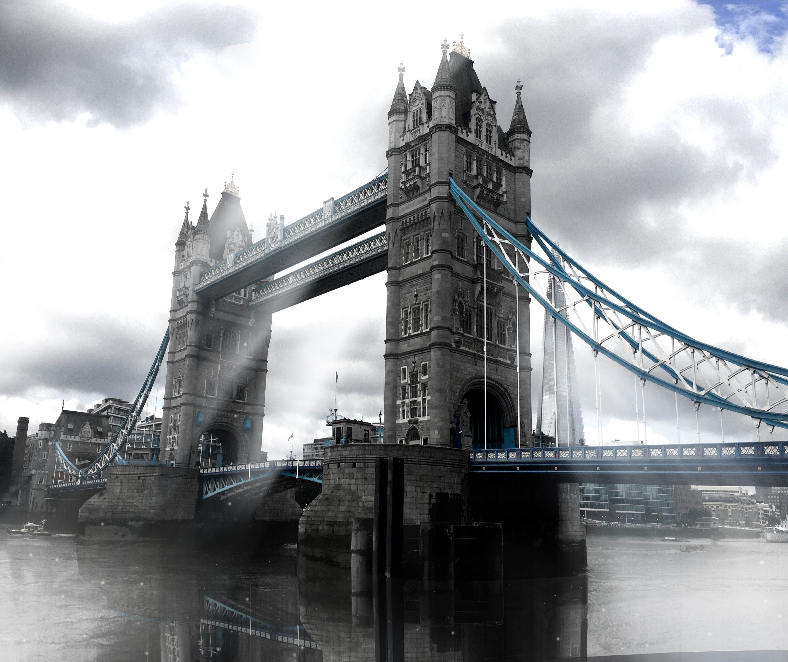 The London Tower Bridge of London, UK, almost black and white, with cloudy light rays