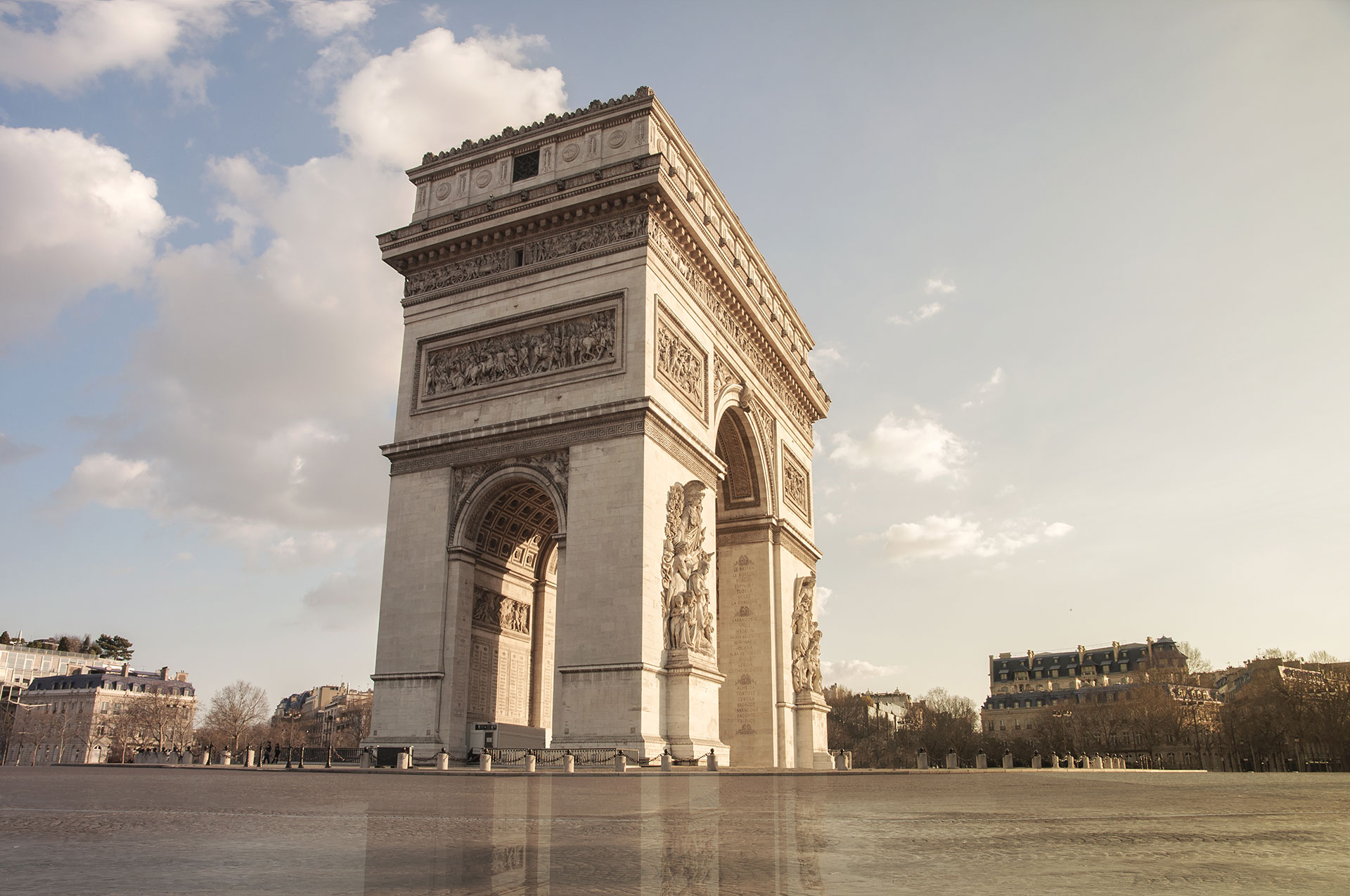 Paris Arc de Triomphe or The Triumphal Arch of Paris Charles-de-Gaulle Etoile, without anybody, no car, no pedestrian because of the quarantine due to the Coronavirus COVID-19 2020 , (Nos Dren)