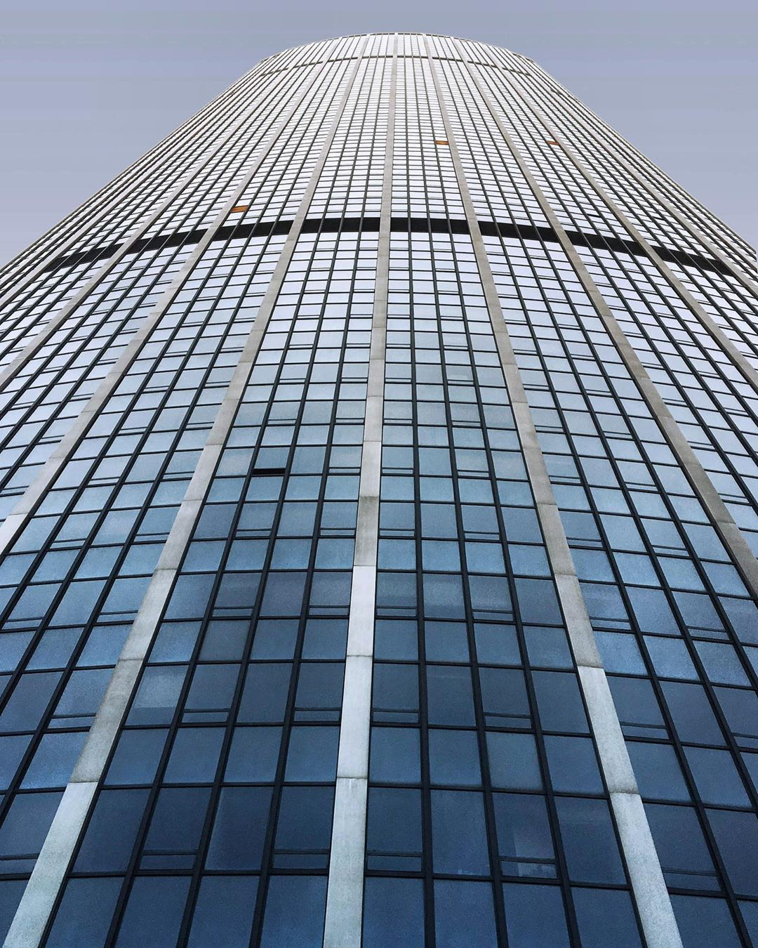 The Montparnasse tower building view from the bottom with perspective, took in Paris, France. (Nos Dren)