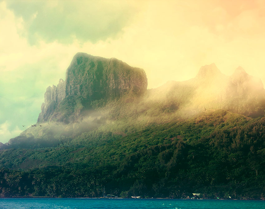 French Polynesia, Bora Bora island, mount Otemanu from aside with clouds, mist and dramatic light. (Nos Dren)