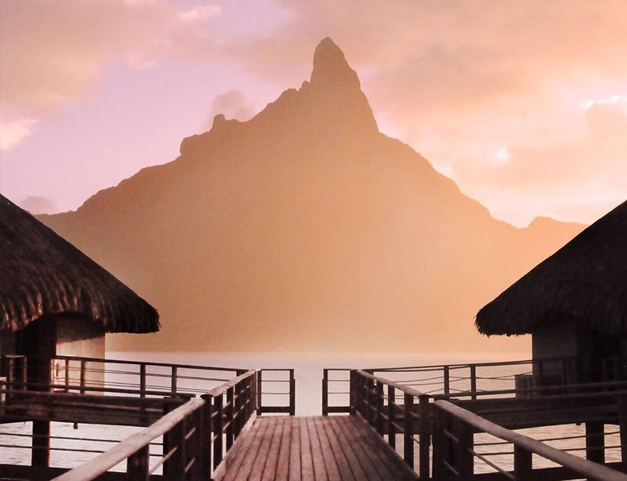 French Polynesia, Bora Bora island, the shadow of the Mount Otemanu in the sunrise fog took from the stilt houses at Le Méridien Bora Hotel. (Nos Dren)