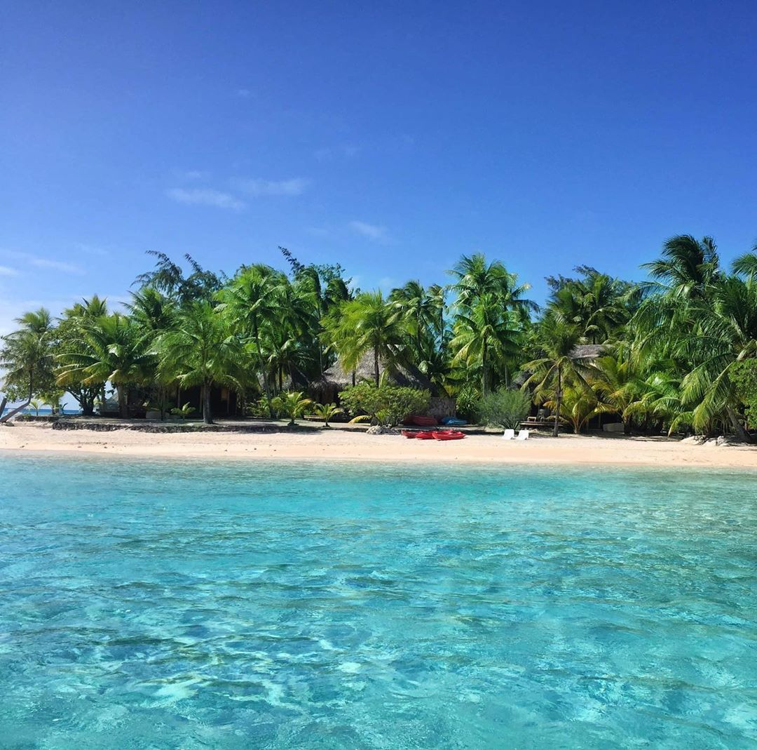 French Polynesia, Tikehau island, paradise beach with incredible transparent blue water, palm trees and white sand. (Nos Dren)